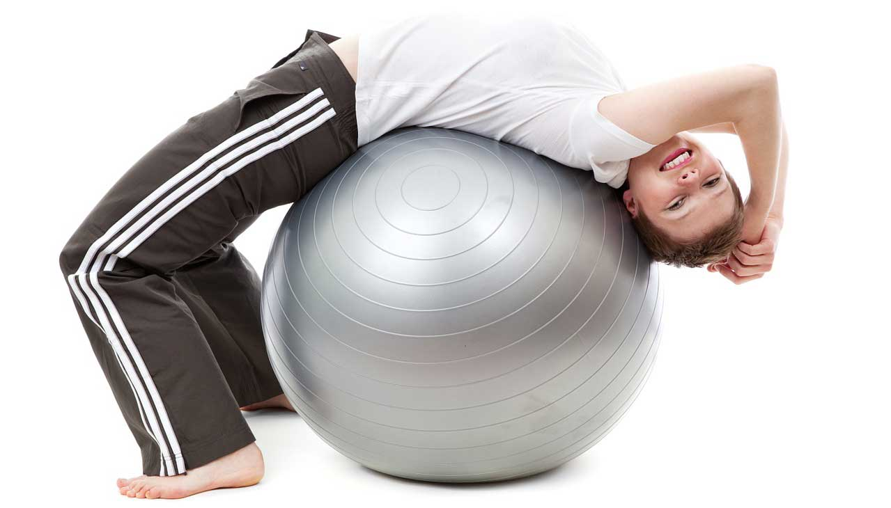 Woman exercising with a medicine ball