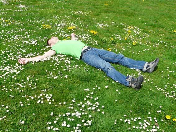 Man lying on a grass field