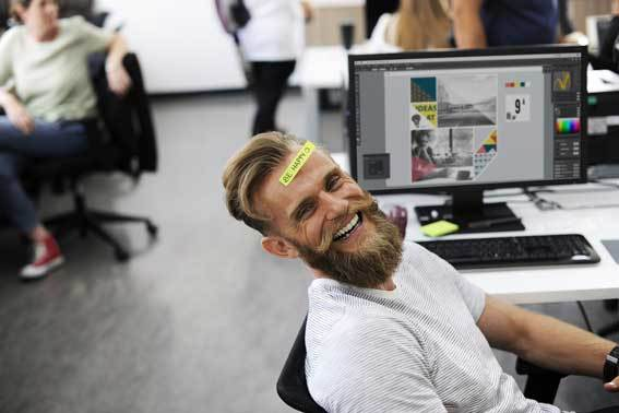 Man at the office smiling