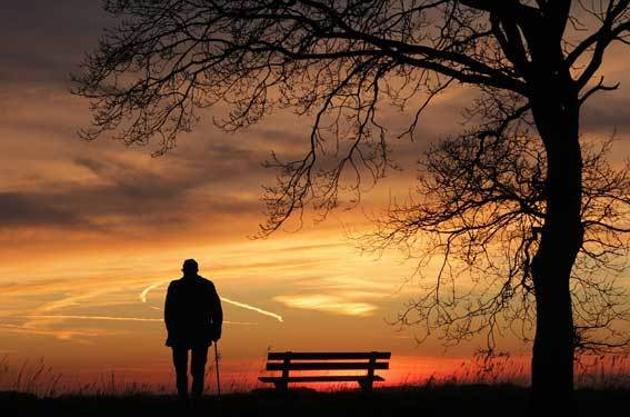 A lonely older man in the sunset