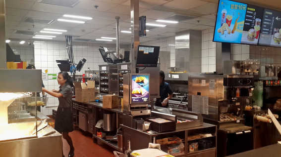 Workers behind the counter in McDonald's