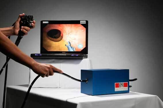 A physcian performing a colonoscopy
