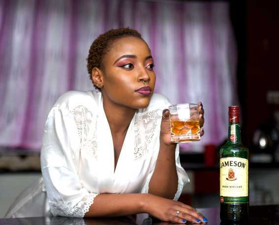 black woman drinking alcohol