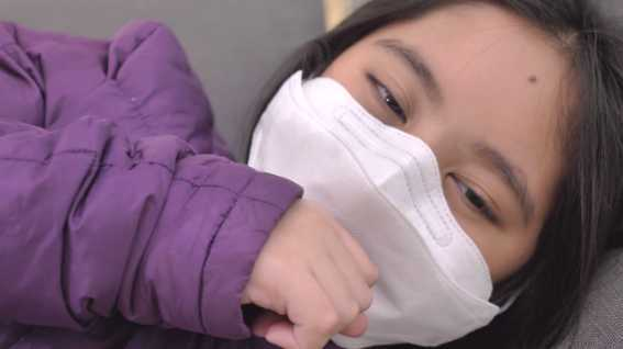 Sick Chinese girl with facemask