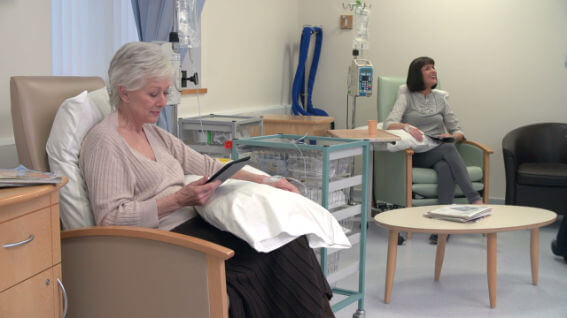 chemo patient sitting in a chair