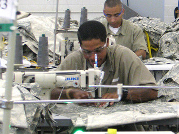 Prisoners sewing clothes