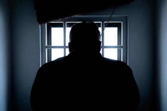 Prisoner in front of a window