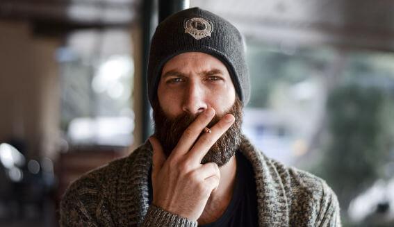 Man in a beard smoking a cigarette