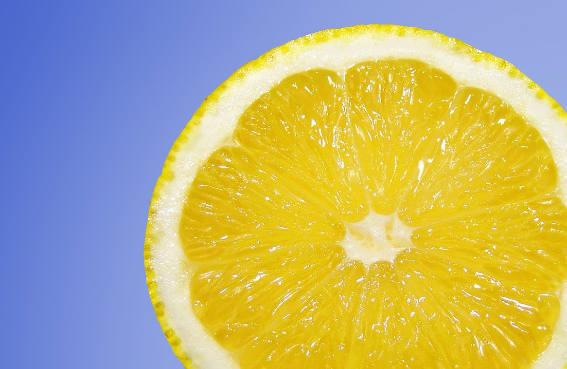 Lemon in front of a blue background
