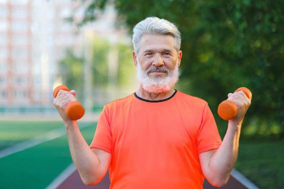 Old man lifting small weights