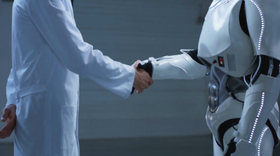 A Human and robot shaking hands