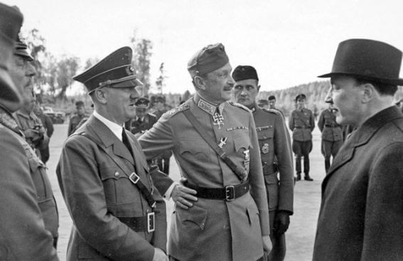 Hitler speaking with other nazis