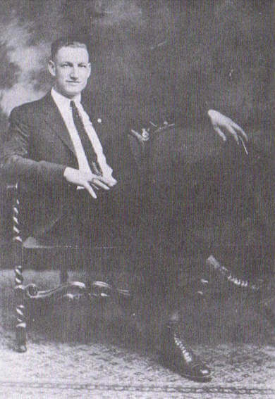 Harry Hoxsey sitting in a chair